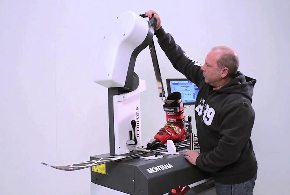 Operator using ski binding control machinery interfaced to RENT-ALL