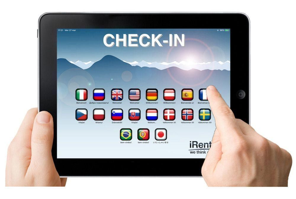 Hands holding tablet that has the checkin on the screen RENT-ALL