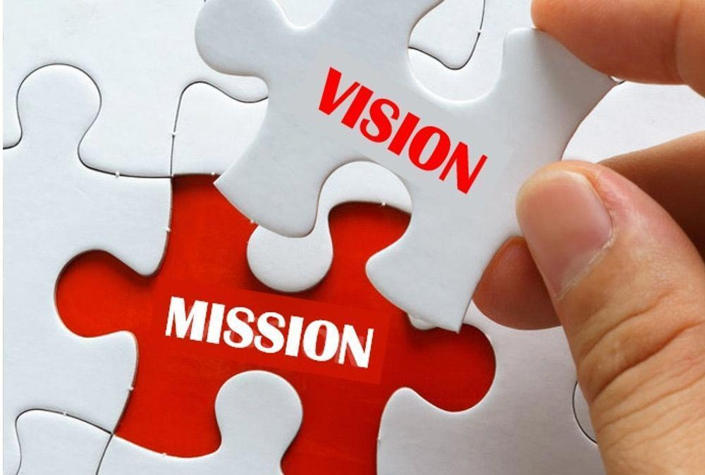 Pieces of a puzzle with mission and vision written