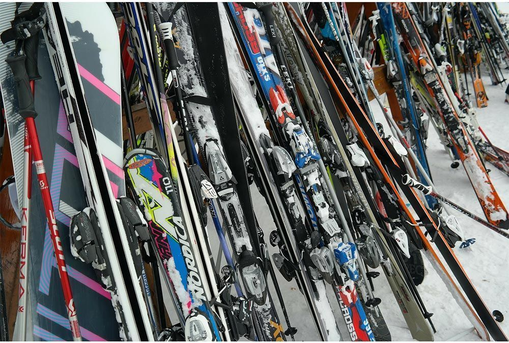 Tangle of skis resting on a rack